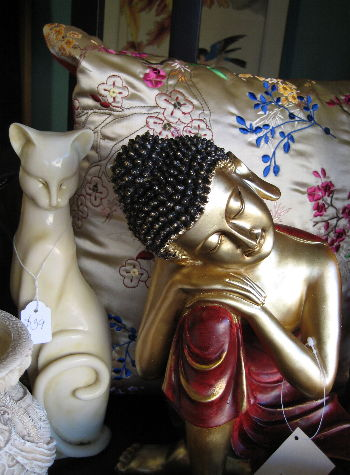 red budda with cat